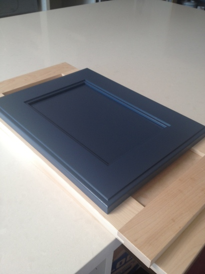 Kitchen cabinet door lacquered in navy blue
